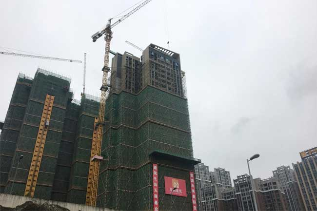 Chinese cities' moves to ease residency curbs fuel property demand