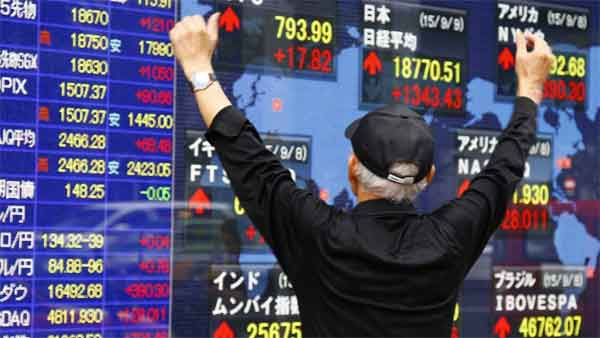 Japan stocks gain in thin trade, defensive sector gets boost