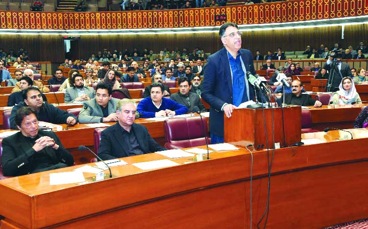 Asad Umar presents third Financial Bill for fiscal 2019 amid opposition's protest